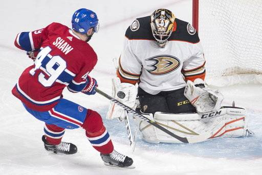 Montreal Canadiens right wing Logan Shaw (49) moves in on Anaheim Ducks goaltender Reto Berra (1) during the second period of an NHL hockey of an NHL hockey game in Montreal, Saturday, Feb. 3, 2018. (Graham Hughes/The Canadian Press via AP)
