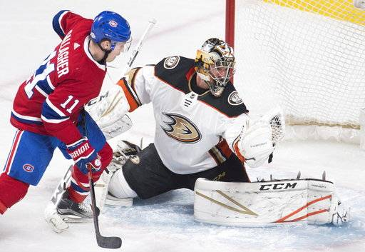 Anaheim Ducks goaltender Reto Berra (1) makes a glove save as Montreal Canadiens right wing Brendan Gallagher (11) looks for a rebound during the second period of an NHL hockey of an NHL hockey game in Montreal, Saturday, Feb. 3, 2018. (Graham Hughes/The Canadian Press via AP)