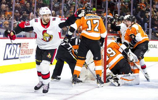 Ottawa Senators' Derick Brassard, left, celebrates after scoring past Philadelphia Flyers' Alex Lyon, right, during the first period of an NHL hockey game, Saturday, Feb. 3, 2018, in Philadelphia.