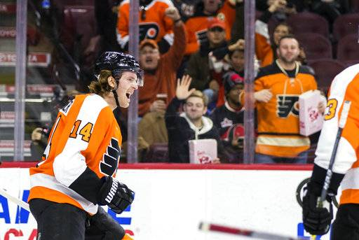 Philadelphia Flyers' Sean Couturier celebrates after scoring a goal during the second period of an NHL hockey game against the Ottawa Senators, Saturday, Feb. 3, 2018, in Philadelphia.