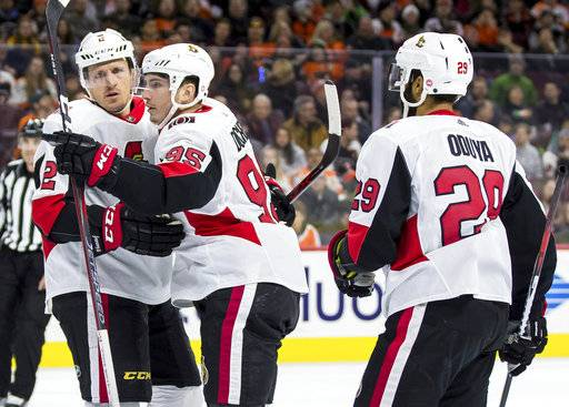 Ottawa Senators' Matt Duchene, center, celebrates his goal with Dion Phaneuf, left, and Johnny Oduya, right, during the first period of an NHL hockey game against the Philadelphia Flyers, Saturday, Feb. 3, 2018, in Philadelphia.