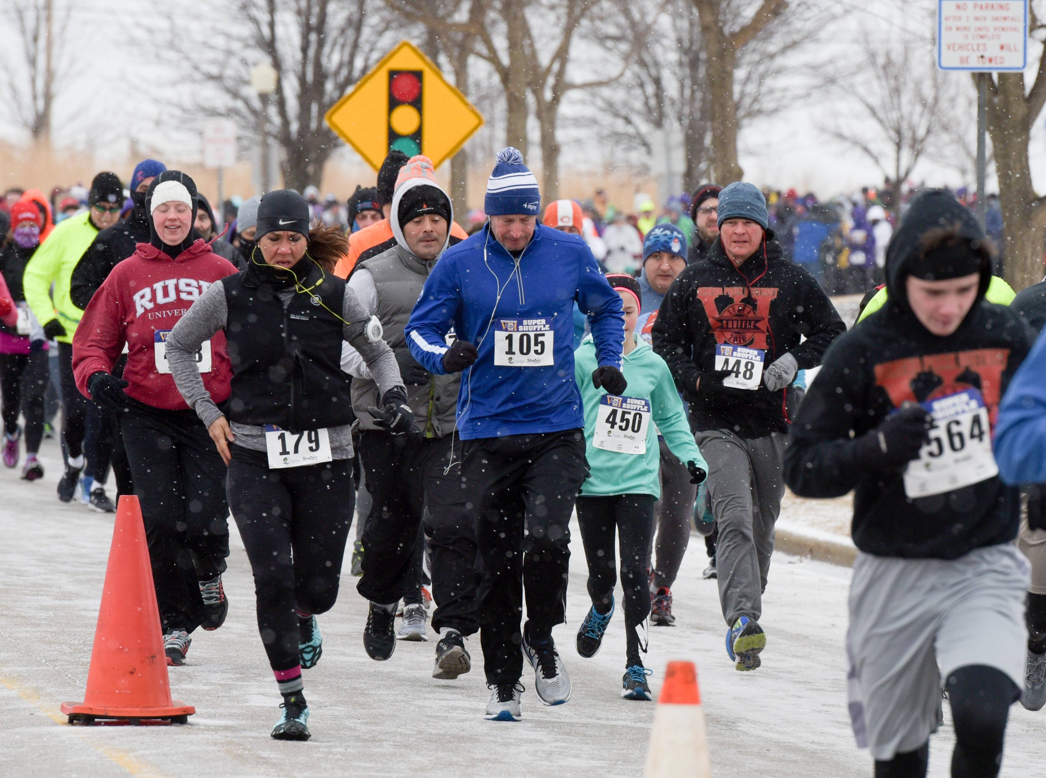 Despite the cold and snow dozens of participants showed up and ran in the annual Super Shuffle 5K in Geneva on Sunday.