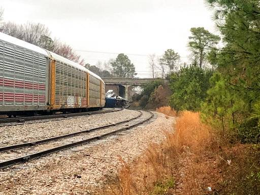 A derailed Amtrak train sits on the track in Cayce, S.C., Sunday, Feb. 4, 2018. The Amtrak passenger train slammed into a freight train parked on a side track in South Carolina early Sunday, killing two Amtrak employees and injuring more than 110 people, authorities said.