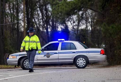 A State Trooper directs people away from the site of an early morning train crash Sunday, Feb. 4,  2018, in Cayce, SC. At least two people were killed and at least 70 people were injured. The crash between the Amtrak train and CSX freight train occurred near Charleston Highway and Pine Ridge Road around 2:35 a.m. Sunday. The lead engine and a few passenger cars derailed.