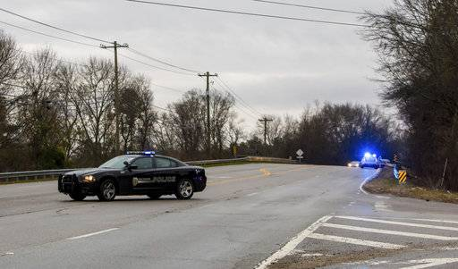 West Columbia police direct people away from the site of an early morning train crash Sunday, Feb. 4,  2018, in Cayce, SC. At least two people were killed and at least 70 people were injured. The crash between the Amtrak train and CSX freight train occurred near Charleston Highway and Pine Ridge Road around 2:35 a.m. Sunday. The lead engine and a few passenger cars derailed.