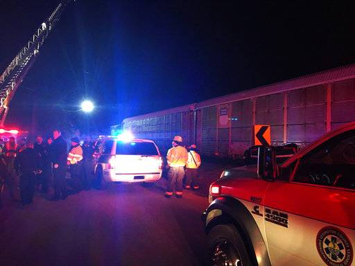 Emergency responders work at the scene of a crash between an Amtrak passenger train and a CSX freight train Sunday, Feb. 4, 2018 in Cayce, S.C. The crash left multiple people dead and dozens of people injured. (Lexington County Sheriff's Department via AP)