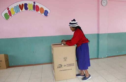 A woman casts her vote during a constitutional referendum called by Ecuador's President Lenin Moreno in Quito, Ecuador, Sunday, Feb. 4, 2018. Moreno called for the nationwide referendum that will include a question asking voters whether they want to revoke a law pushed forward by his predecessor allowing presidents to be indefinitely re-elected.