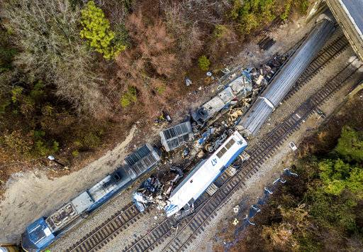 An aerial view of the site of an early morning train crash Sunday, Feb. 4, 2018 between an Amtrak train, bottom right, and a CSX freight train, top left, in Cayce, SC. The Amtrak passenger train slammed into a freight train in the early morning darkness Sunday, killing at least two Amtrak crew members and injuring more than 110 people, authorities said.