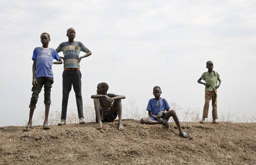 In this photo taken Saturday, Jan. 20, 2018, children stand on the banks of the Nile overlooking the Ethiopian border in Akobo town, one of the last rebel-held strongholds in South Sudan. Child abductions have risen during South Sudan's civil war as desperate people try to make a living, and one child, no matter the age, is said to sell for 20 cows, worth about $7,000.