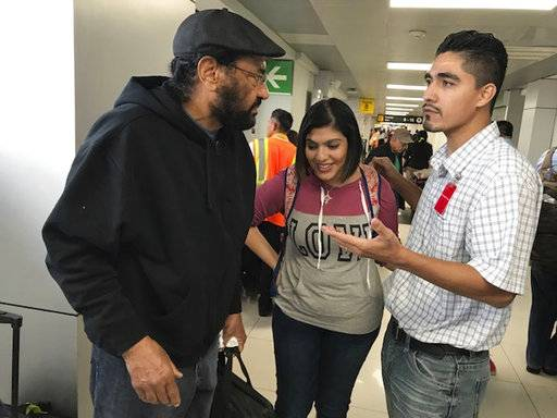 U.S. Rep. Al Green, left, meets Jose Escobar and his wife, Rose, at the airport in San Salvador, El Salvador, on Saturday, Feb. 3, 2018, for a meeting that the Houston Democrat hopes will call attention to the plight of deported families. Jose Escobar was deported in March despite not having a criminal record, according to his family.
