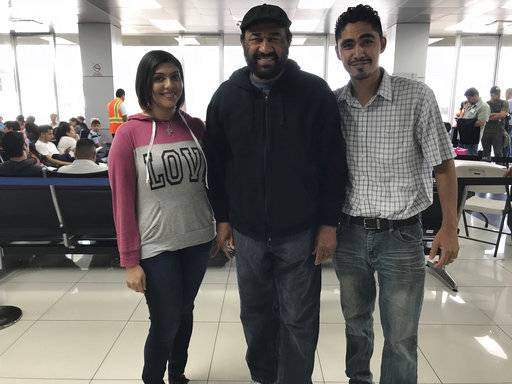 U.S. Rep. Al Green, center, meets Jose Escobar and his wife, Rose, at the airport in San Salvador, El Salvador, on Saturday, Feb. 3, 2018, for a meeting that the Houston Democrat hopes will call attention to the plight of deported families. Jose Escobar was deported in March despite not having a criminal record, according to his family.