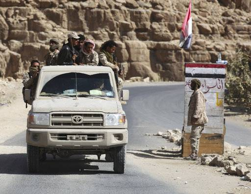 In this Friday, Feb. 2, 2018, photograph, Yemeni militiamen and soldiers allied to the country's internationally recognized government pass through a mountain checkpoint in the outskirts of Sanaa, Yemen. Yemen's conflict, which began as a civil war in 2014 and escalated into a regional proxy fight, drags on today. Winning the hardscrabble terrain takes time and costs dearly, only exacerbating the country's humanitarian crises and making a war that's seen over 10,000 people killed last that much longer.
