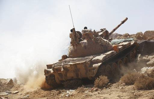 In this Friday, Feb. 2, 2018 photograph, Yemeni soldiers allied to the country's internationally recognized government drive a tank on the outskirts of Sanaa, Yemen. Yemen's conflict, which began as a civil war in 2014 and escalated into a regional proxy fight, drags on today. Winning the hardscrabble terrain takes time and costs dearly, only exacerbating the country's humanitarian crises and making a war that's seen over 10,000 people killed last that much longer.