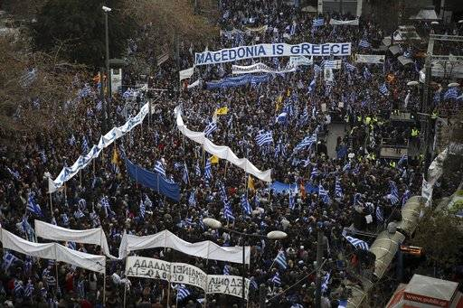 Protesters gather during a rally in Athens, Sunday, Feb. 4, 2018. Protesters from across Greece converged Sunday on Athens' main square outside parliament to protest a potential Greek compromise in a dispute with neighboring Macedonia over the former Yugoslav republic's official name.