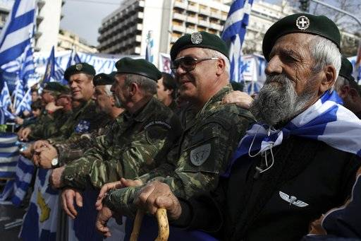 Greek army veterans attend a rally in Athens, Sunday, Feb. 4, 2018. Protesters gather in the Greek capital for a massive rally to protest a potential Greek compromise in a dispute with neighboring Macedonia over the former Yugoslav republic's official name.