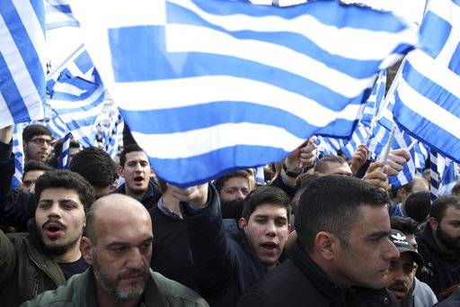 Protesters shout slogans during a rally in Athens, Sunday, Feb. 4, 2018. Protesters gather in the Greek capital for a massive rally to protest a potential Greek compromise in a dispute with neighboring Macedonia over the former Yugoslav republic's official name.