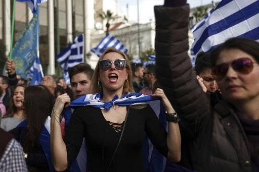 A protester shouts slogans during a rally in Athens, Sunday, Feb. 4, 2018. Tens of thousands of protesters were thronging the Greek capital's main square outside parliament Sunday to protest a potential Greek compromise in a dispute with neighboring Macedonia over the former Yugoslav republic's official name.