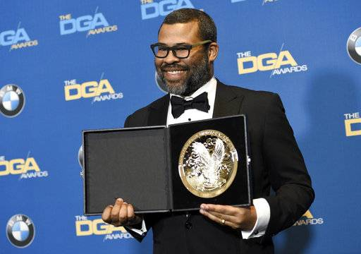 "Jordan Peele poses in the press room with a medallion honoring his nomination for outstanding directorial achievement in a feature film for ""Get Out"" at the 70th annual Directors Guild of America Awards at The Beverly Hilton hotel on Saturday, Feb. 3, 2018, in Beverly Hills, Calif. (Photo by Chris Pizzello/Invision/AP)"