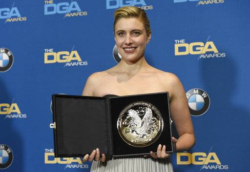"Greta Gerwig poses in the press room with a medallion honoring her nomination for outstanding directorial achievement in a feature film for ""Lady Bird"" at the 70th annual Directors Guild of America Awards at The Beverly Hilton hotel on Saturday, Feb. 3, 2018, in Beverly Hills, Calif. (Photo by Chris Pizzello/Invision/AP)"