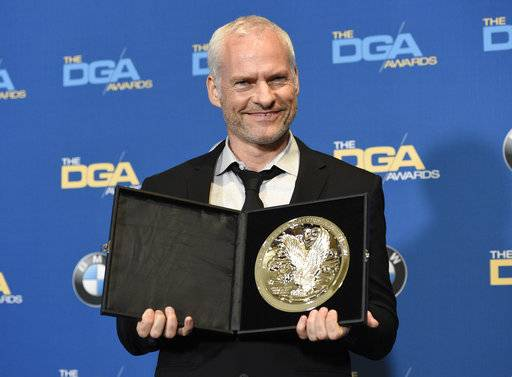 "Martin McDonagh poses in the press room with a medallion honoring his nomination for outstanding directorial achievement in a feature film for ""Three Billboards Outside Ebbing, Missouri"" at the 70th annual Directors Guild of America Awards at The Beverly Hilton hotel on Saturday, Feb. 3, 2018, in Beverly Hills, Calif. (Photo by Chris Pizzello/Invision/AP)"