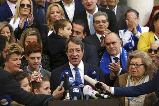 Cyprus' president Nicos Anastasiades and Cypriot Presidential candidate makes statements after he voted in the presidential elections in southern coastal city of Limassol, Cyprus, on Sunday, Feb. 4, 2018. Cypriots are voting in the second round for a new president they hope will overcome years of failure to resolve the island-nation's ethnic division and deliver more benefits from an economy on the rebound after a severe financial crisis.