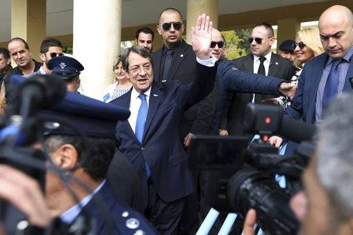 Cyprus' president Nicos Anastasiades and Cypriot Presidential candidate waves to his supporters after he voted in the presidential elections in southern coastal city of Limassol, Cyprus, on Sunday, Feb. 4, 2018. Cypriots are voting in the second round for a new president they hope will overcome years of failure to resolve the island-nation's ethnic division and deliver more benefits from an economy on the rebound after a severe financial crisis.
