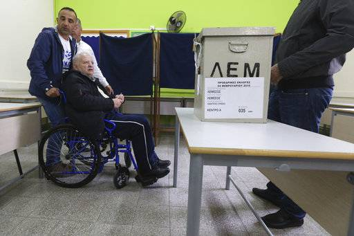 An elderly man in a wheelchair votes during the presidential elections in south coastal city of Limassol, Cyprus, on Sunday, Feb. 4, 2018. Cypriots will vote in the second round for a new president with critical topics including the reunification of the divided island and economic recovery.