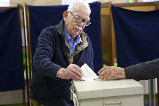 An elderly man votes during the presidential elections in south coastal city of Limassol, Cyprus, on Sunday, Feb. 4, 2018. Cypriots will vote in the second round for the new president with critical topics including the reunification of the divided island and economic recovery.