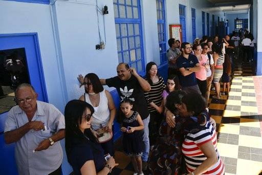 Voters are seen at a polling station during presidential election in San Jose, Costa Rica, Sunday, Feb. 4, 2018. Costa Rica will hold general elections on Sunday, Feb. 4. Costa Ricans voted Sunday in a presidential race shaken by an international court ruling saying the country should let same-sex couples get married.