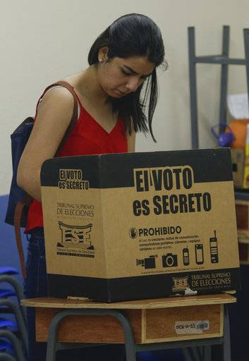 "A woman casts her ballot behind a box cover that reads in Spanish ""The vote is secret."" during a general elections in San Jose, Costa Rica, Sunday, Feb. 4, 2018. Costa Ricans voted Sunday in a presidential race shaken by an international court ruling saying the country should let same-sex couples get married."