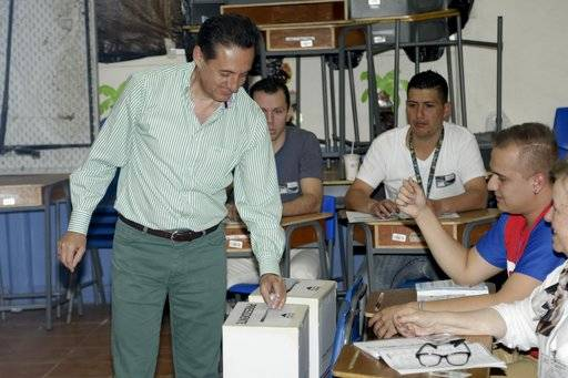 Presidential candidate Antonio Alvarez Desanti, with National Liberation party, casts his ballot at a polling station during general elections in San Jose, Costa Rica, Sunday, Feb. 4, 2018. Costa Ricans voted Sunday in a presidential race shaken by an international court ruling saying the country should let same-sex couples get married.