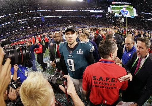 Philadelphia Eagles quarterback Nick Foles (9) walks on the field after winning the NFL Super Bowl 52 football game against the New England Patriots, Sunday, Feb. 4, 2018, in Minneapolis. The Eagles won 41-33.