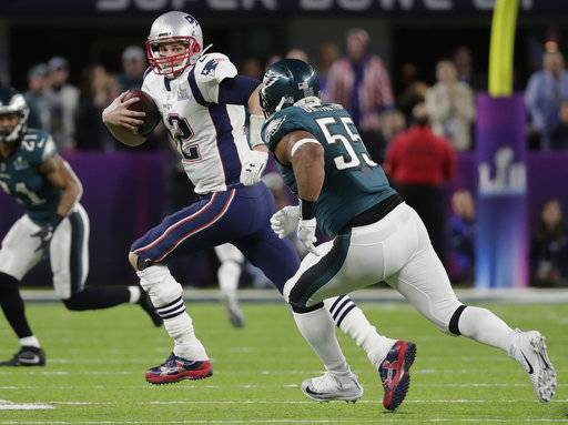 New England Patriots quarterback Tom Brady (12) scrambles against Philadelphia Eagles defensive end Brandon Graham (55), during the first half of the NFL Super Bowl 52 football game, Sunday, Feb. 4, 2018, in Minneapolis.
