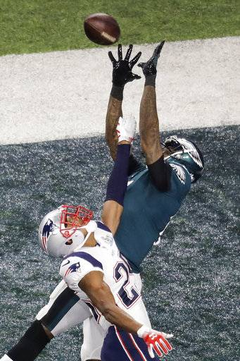Philadelphia Eagles wide receiver Alshon Jeffery catches a touchdown pass over New England Patriots cornerback Eric Rowe during the first half of the NFL Super Bowl 52 football game Sunday, Feb. 4, 2018, in Minneapolis.
