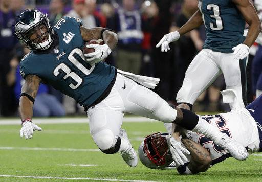 Philadelphia Eagles' Corey Clement is stopped by New England Patriots' Patrick Chung after catching a pass during the first half of the NFL Super Bowl 52 football game Sunday, Feb. 4, 2018, in Minneapolis.