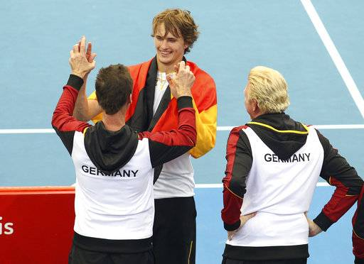 Alexander Zverev of Germany, center, celebrates with his team after he won his match against Nick Kyrgios of Australia at the Davis Cup World Group first round in Brisbane, Australia, Sunday, Feb. 4, 2018.