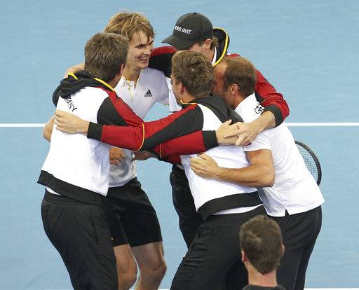 German team celebrate after compatriot Alexander Zverev, second from left, won over Nick Kyrgios of Australia at the Davis Cup World Group first round in Brisbane, Australia, Sunday, Feb. 4, 2018.