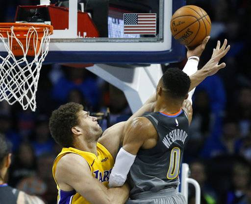 Los Angeles Lakers center Brook Lopez, left, fouls Oklahoma City Thunder guard Russell Westbrook (0) as Westbrook shoots in the first half of an NBA basketball game in Oklahoma City, Sunday, Feb. 4, 2018.