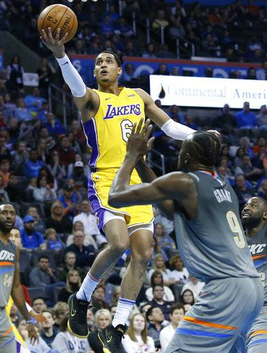 Los Angeles Lakers guard Jordan Clarkson (6) goes to the basket in front of Oklahoma City Thunder forward Jerami Grant (9) in the first half of an NBA basketball game in Oklahoma City, Sunday, Feb. 4, 2018.
