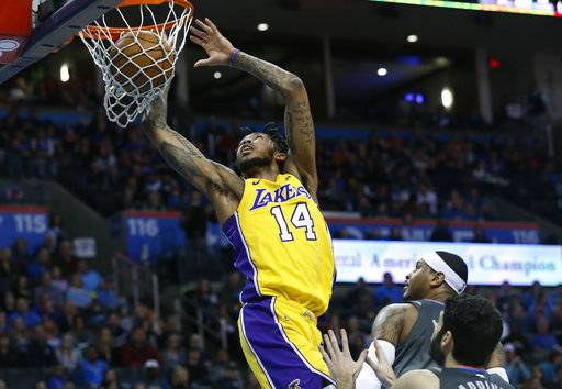 Los Angeles Lakers forward Brandon Ingram (14) dunks in front of Oklahoma City Thunder forward Carmelo Anthony, center, and guard Alex Abrines, right, in the first half of an NBA basketball game in Oklahoma City, Sunday, Feb. 4, 2018.