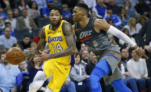Los Angeles Lakers forward Brandon Ingram (14) drives around Oklahoma City Thunder guard Russell Westbrook (0) in the first half of an NBA basketball game in Oklahoma City, Sunday, Feb. 4, 2018.