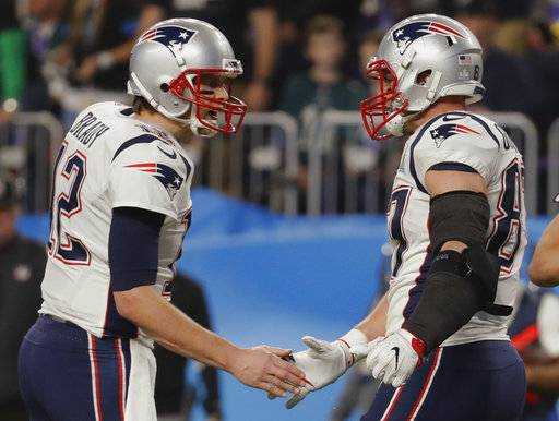 New England Patriots quarterback Tom Brady (12) and tight end Rob Gronkowski (87) celebrates a touchdown, during the second half of the NFL Super Bowl 52 football game against the Philadelphia Eagles, Sunday, Feb. 4, 2018, in Minneapolis.