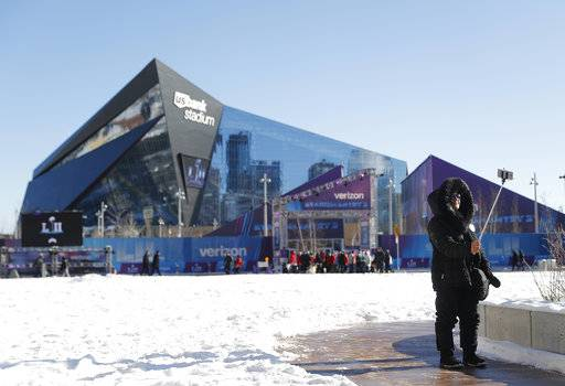Beno Naeunan takes a selfie outside U.S. Bank Stadium before the NFL Super Bowl 52 football game between the Philadelphia Eagles and the New England Patriots Sunday, Feb. 4, 2018, in Minneapolis.