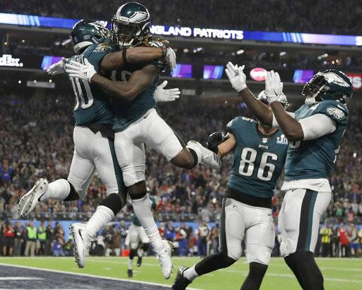 Philadelphia Eagles' Corey Clement, left, celebrates his touchdown catch during the second half of the NFL Super Bowl 52 football game against the New England Patriots Sunday, Feb. 4, 2018, in Minneapolis.