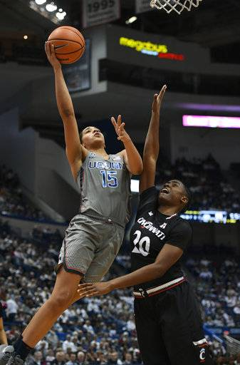 Connecticut's Gabby Williams shoots a basket over Cincinnati's Maya Benham, right, during the second half of an NCAA college basketball game, Sunday, Feb. 4, 2018, in Hartford, Conn.