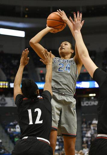 Connecticut's Napheesa Collier shoots over Cincinnati's Antoinette Miller during the second half of an NCAA college basketball game, Sunday, Feb. 4, 2018, in Hartford, Conn.