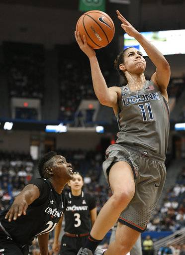 Connecticut's Kia Nurse, right, drives to the basket past Cincinnati's Shanice Johnson, left, during the first half of an NCAA college basketball game, Sunday, Feb. 4, 2018, in Hartford, Conn.