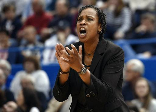 Cincinnati head coach Jamelle Elliott calls to her team during the first half of an NCAA college basketball game against Connecticut, Sunday, Feb. 4, 2018, in Hartford, Conn.