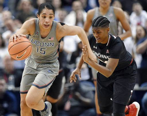 Connecticut's Gabby Williams, left, is pursued by Cincinnati's Maya Benham, right, during the second half of an NCAA college basketball game, Sunday, Feb. 4, 2018, in Hartford, Conn.