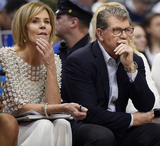 Connecticut head coach Geno Auriemma, right, and associate head coach Chris Dailey watch reserves play during the second half of an NCAA college basketball game against Cincinnati, Sunday, Feb. 4, 2018, in Hartford, Conn.